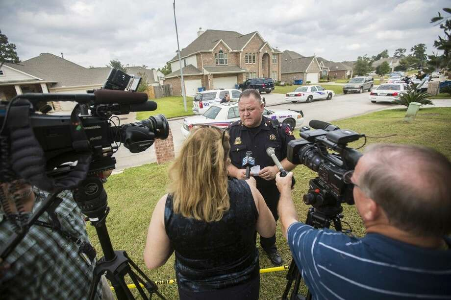 Harris County Precinct 4 Constable lieutenant Walter Stensland speaks to the media at the scene of an attempted burglary on the 8700 block of Rolling Rapids Road in Atascocita. Photo: ANDREW BUCKLEY