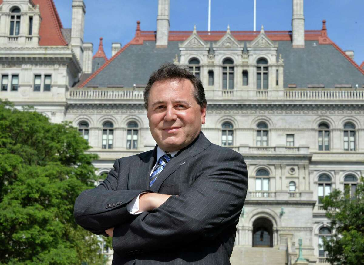 St. Rose professor Bruce Roter in front of the State Capitol in Albany, NY, Wednesday July 31, 2013. (John Carl D'Annibale / Times Union)