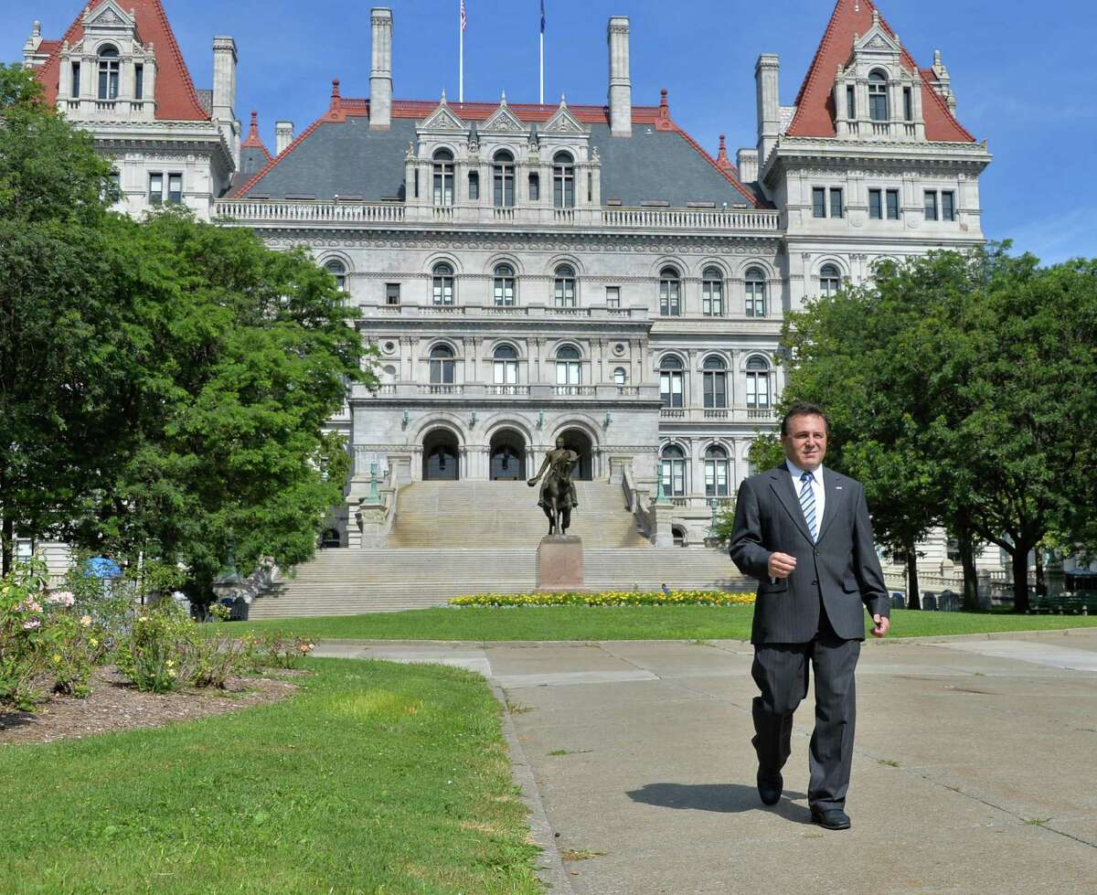 St. Rose professor Bruce Roter outside the State Capitol in Albany, NY, Wednesday July 31, 2013. (John Carl D'Annibale / Times Union)