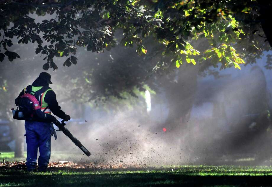 Members of the Albany Department of General Services start the fall tradition of blowing and gathering leaves in Washington Park Wednesday Oct.  5,  2016  in Albany, N.Y.  (Skip Dickstein/Times Union) Photo: SKIP DICKSTEIN