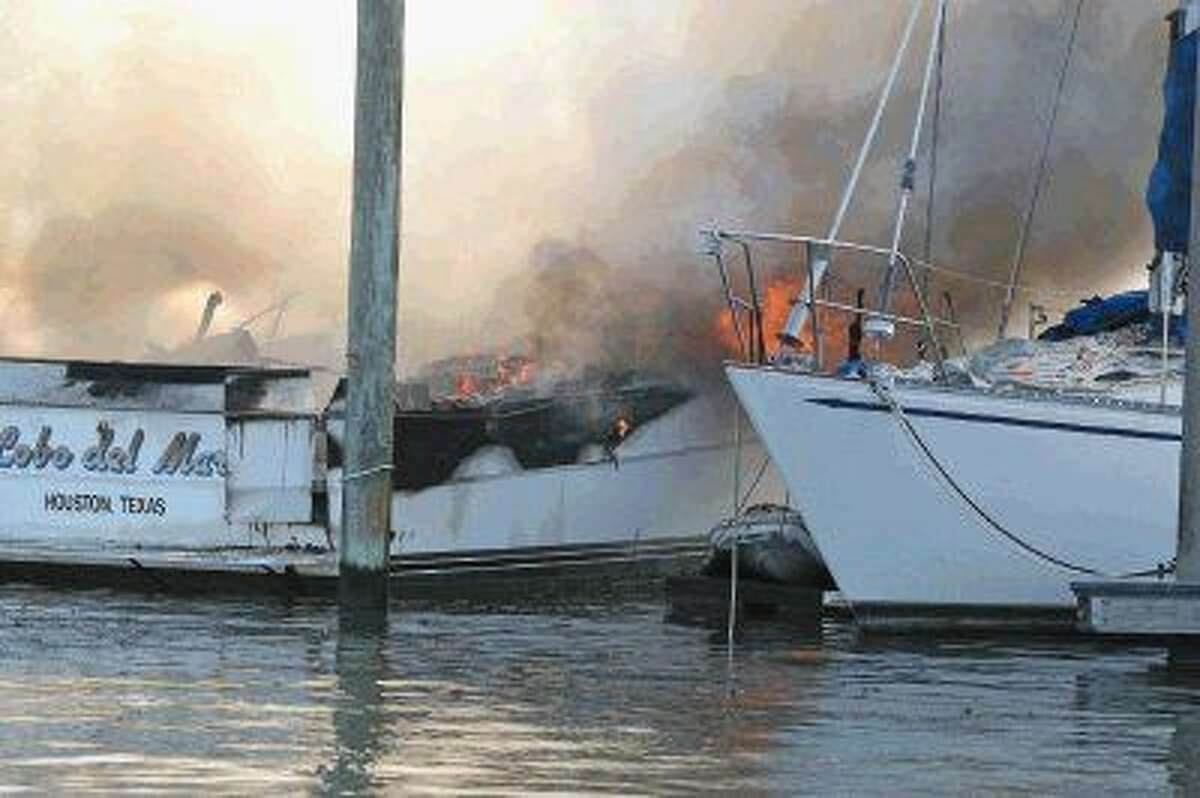 Two boats caught fire Thursday at the Kemah Marina, here a sailboat is docked close to one of the boats on fire and presumably may have some heat damage.