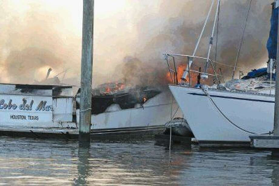 Two boats caught fire Thursday at the Kemah Marina, here a sailboat is docked close to one of the boats on fire and presumably may have some heat damage. Photo: Kar B Hlava