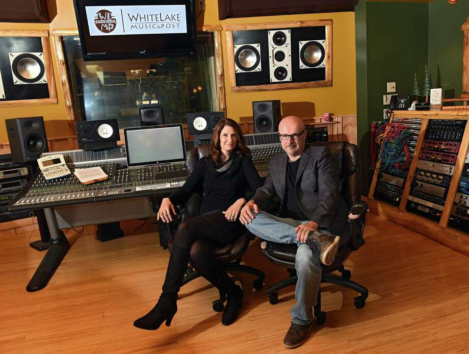 Owners Anna and David Bourgeois sit in one of the studios in White Lake Music & Post on Wednesday, Sept. 28, 2016 in Albany, N.Y.  White Lake Music & Post is a four-studio recording and audio post production facility. (Lori Van Buren / Times Union) Photo: Lori Van Buren / 40038138A