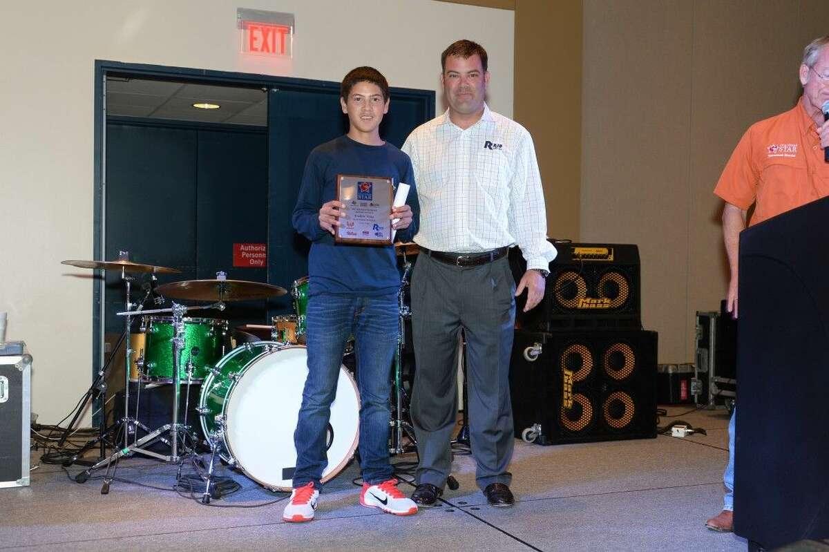Freddie Velez beams after receiving the StarTeens Flounder $20,000 scholarship at the Oct. 9 CCA Awards banquet.