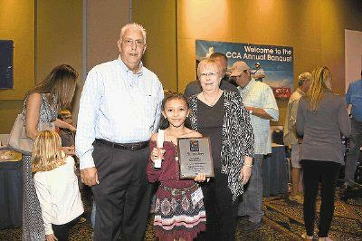 Maritza Martinez with Jason Joseph and Susan Rovegno of Houston Community Newspapers at the Oct. 9 CCA awards banquet. Martinez received the HCN StarKid Sheepshead $50,000 college scholarship.