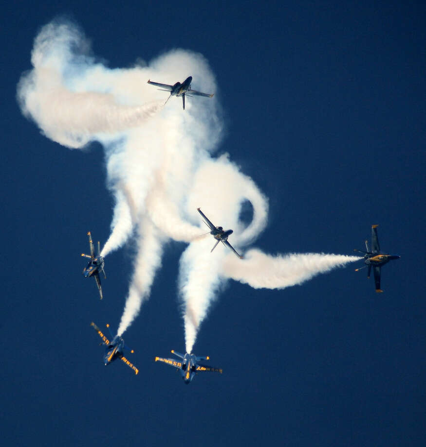 The Blue Angels perform one of their maneuvers Saturday November 1, 2014 at Wings Over Houston Airshow. Photo: Kar B Hlava