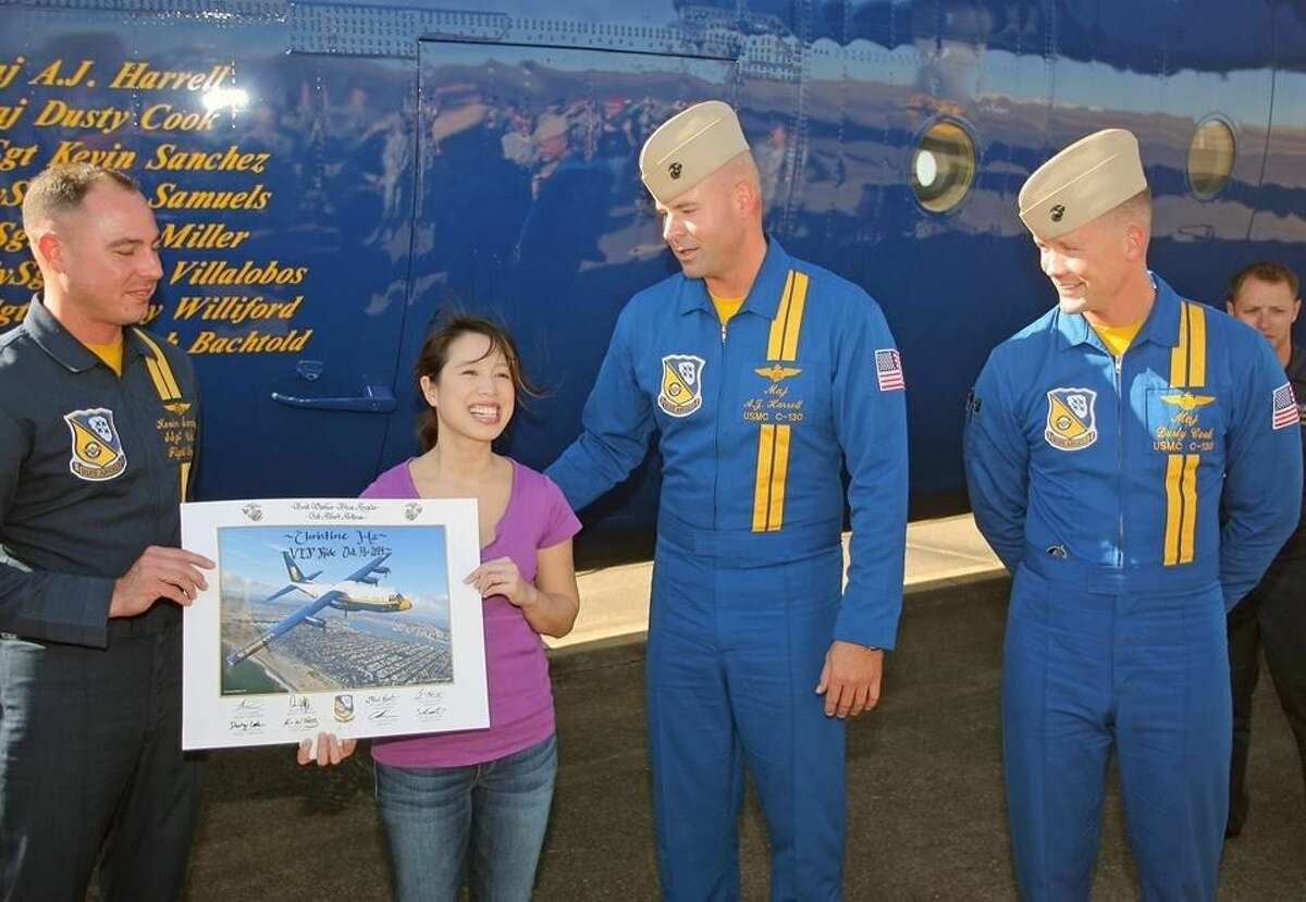Christine Ha receives an autographed photo from the crew of