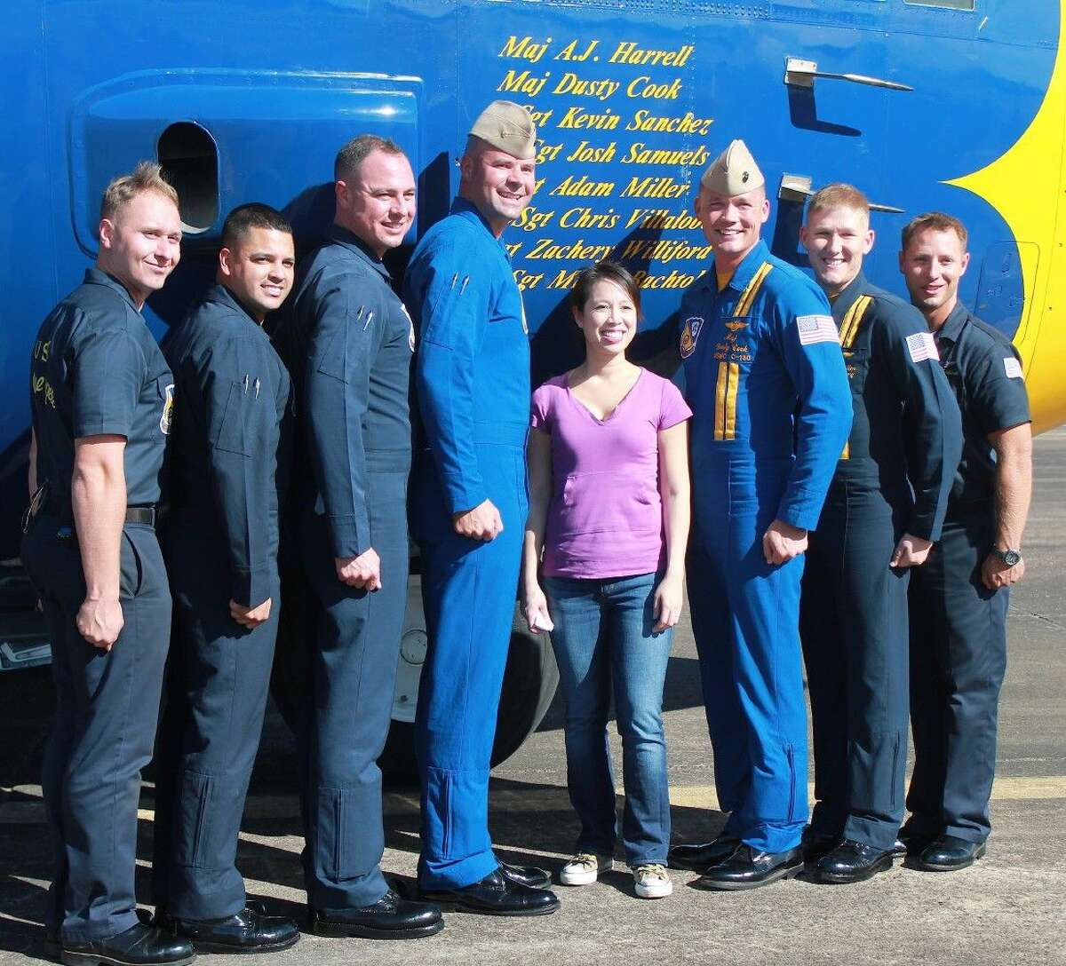 Christine Ha poses with the crew of the Blue Angels C-130.