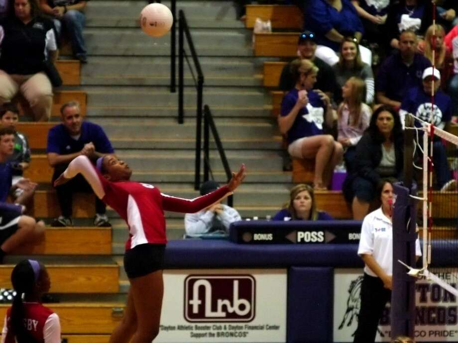 Crosby sophomore Paris Netherly attacks at Dayton, Oct. 16, 2015. She was the Lady Cougars' kill leader for the match, making 13 successful attacks. Crosby won, 3-0. Photo: Casey Stinnett