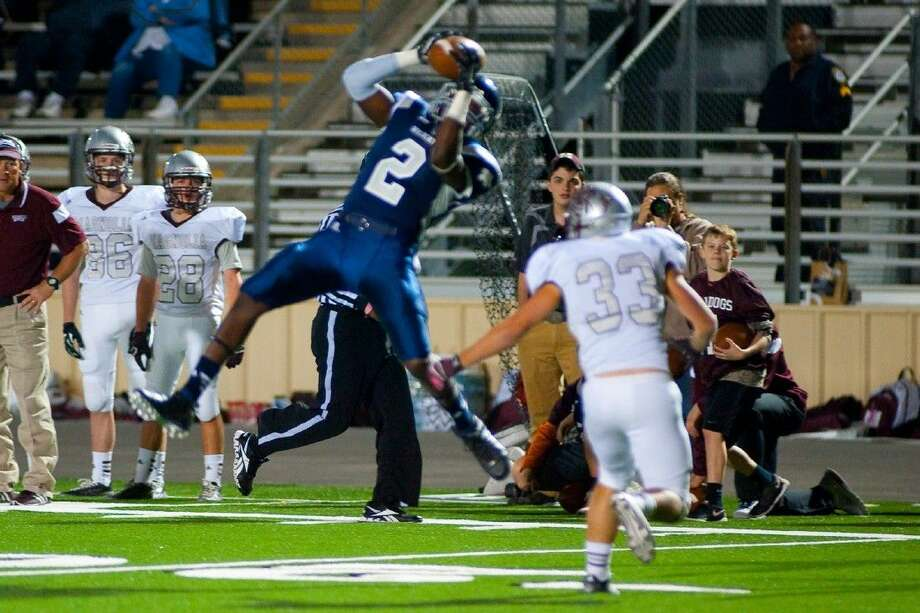 Tomball Memorial wide receiver Lawrence Jackson makes an incredible catch down the field from quarterback Austin Kelley in a 21-10 loss to Magnolia on Friday, October 31. Photo: Tony Gaines