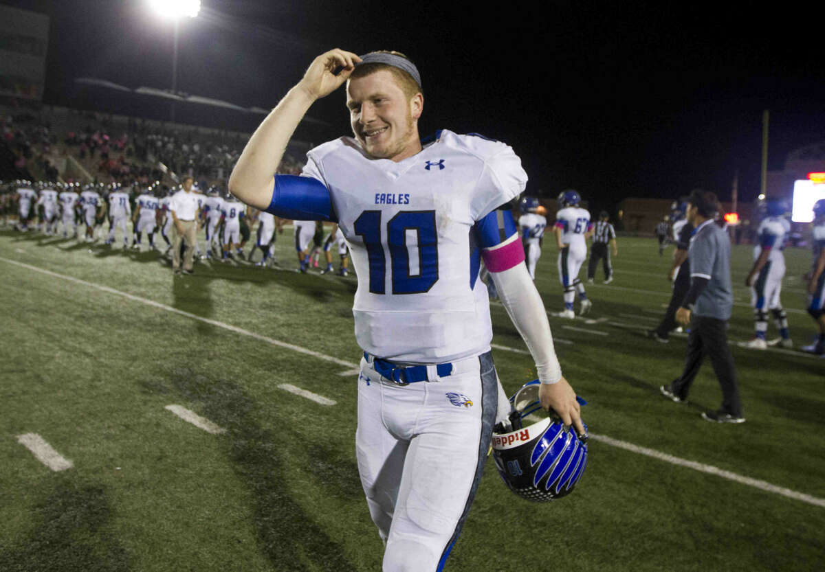 New Caney quarterback Timmy Ware was all smiles after throwing four touchdown and running for two more to lead the Eagles to a 55-16 win over Kingwood Park seal the school's first playoff spot since 2003.