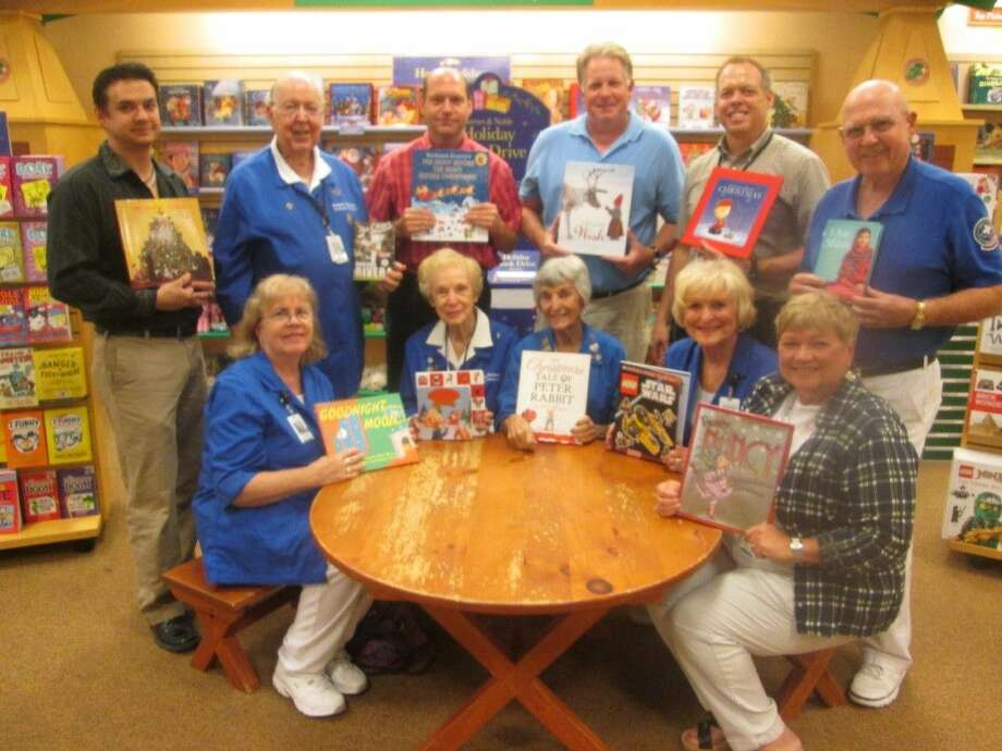 "Memorial Hermann Northeast Hospital Volunteers joined executives from Barnes & Noble recently to kick off the 9th annual Holiday Book Drive and encourage customers to purchase a book during the holidays for the ""Book Buster"" kids. Volunteers pictured seated, from left, Alison Olson, Frances Herring, Peggy Alcorn, Janie Dampier, and Nancy Allen, manager of volunteer services. Standing, from left, Kevin Boney, Barnes & Noble Deerbrook assistant manager; Volunteer Bob Herring; Larry Williams, community business development manager; Mike Usry, district manager; Kevin Prejean, store manager; and Volunteer Hap Hartley."