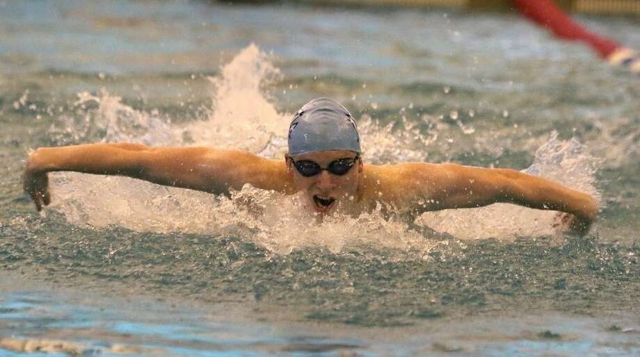 Colin Crow led the Clements Blue team with victories in the 50-yard butterfly and 100-yard backstroke at the Fort Bend Classic, Oct. 16-17 at Don Cook Natatorium. Clements dominated the boys division, with the White team placing first and Blue second. Photo: HCN File Photo