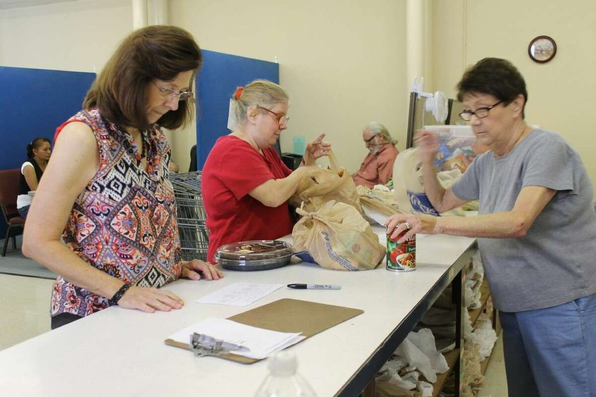 TEAM volunteers package food for families at the ministry's food bank.