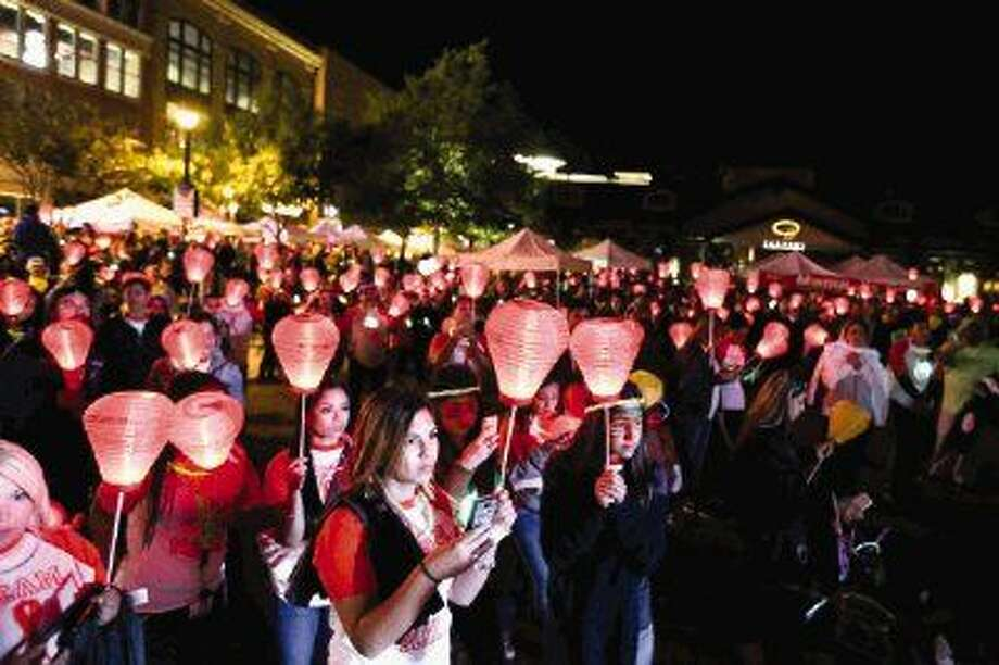 Charming Attendees Hold Up Lanterns During The 10th Annual Light The Night Walk  Listen To Speakers On Design