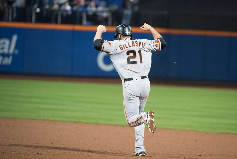 Conor Gillaspie celebrates as he rounds the bases after hitting the home run that provided the only runs in the Giants' win. Photo: Andrew Theodorakis, Special To The Chronicle