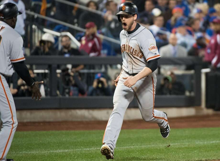 San Francisco Giants third baseman Conor Gillaspie (21) hits a three run home run in the 9th inning the NL Wild Card Playoff game between the New York Mets on Wednesday, October 5th, 2016. Photo: Andrew Theodorakis, Special To The Chronicle