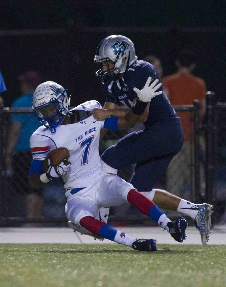 Oak Ridge wide receiver Lamar Handy is brought down during a football game Friday. To view or purchase this photo and others like it, visit HCNpics.com. Photo: Jason Fochtman