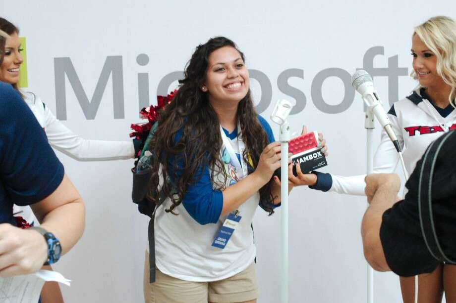 Juanita Alanis reacts as Houston Texans cheerleaders present her with a Microsoft Jambox during the Microsoft Store grand opening celebration at Baybrook Mall Thursday, Nov. 6. Photo: Kirk Sides