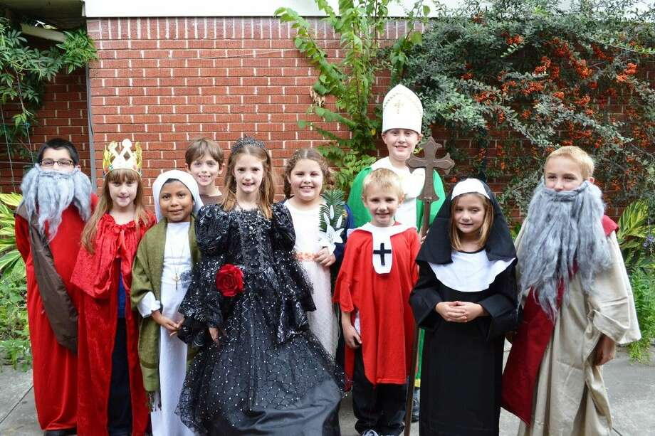 Pictured are third grade St. Anne's students, from left to right, Matthew Mramor as St. Matthew, Mandy Gergen as St. Helen, Gaby Alsup as St. Martha, Joey Malavase as St. Anthony of Pauda, Savannah Davis as St. Elizabeth of Portugal, Karilyn Debelo as St. Maria Goretti, Athan Regitz at St. Athanasius, Jacob Gergen as St. Patrick, Megan Murello as St. Rita of Cascia and Luke Sadenwater as St. Luke. Photo: Submitted