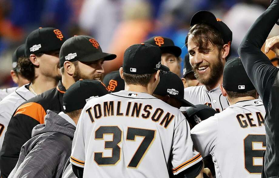 Pitcher Madison Bumgarner (right) is surrounded by teammates after the Giants beat the New York Mets 3-0 in the NL Wild Card game. Photo: Elsa, Getty Images