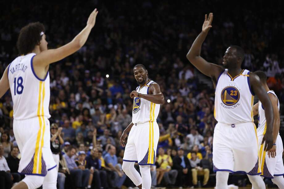 OAKLAND, CA - OCTOBER 04:  Kevin Durant #35 of the Golden State Warriors while Anderson Varejao #18 and Draymond Green #23 high five during their preseason game against the Los Angeles Clippers at ORACLE Arena on October 4, 2016 in Oakland, California.  NOTE TO USER: User expressly acknowledges and agrees that, by downloading and or using this photograph, User is consenting to the terms and conditions of the Getty Images License Agreement.  (Photo by Ezra Shaw/Getty Images) Photo: Ezra Shaw, Getty Images