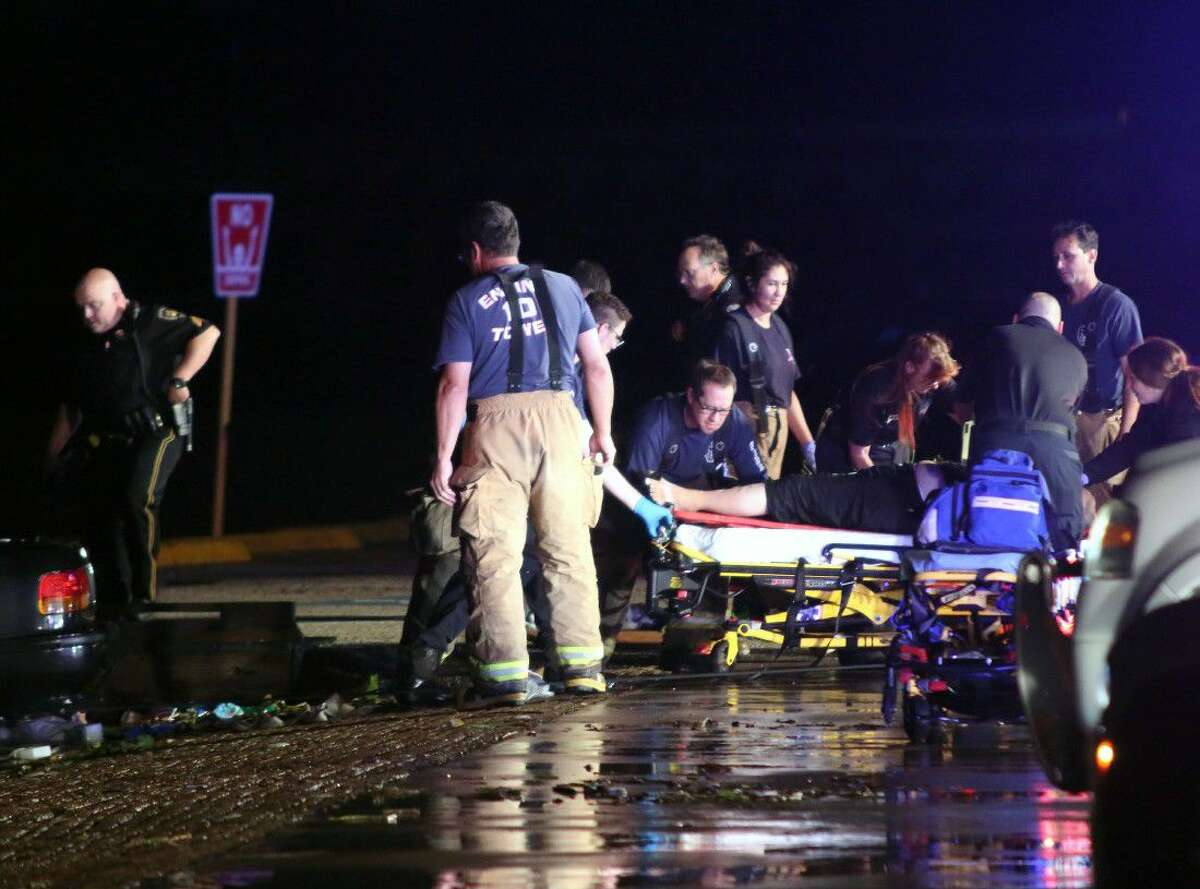 Emergency personnel administer cpr on the woman after she was pulled from the submerged car.