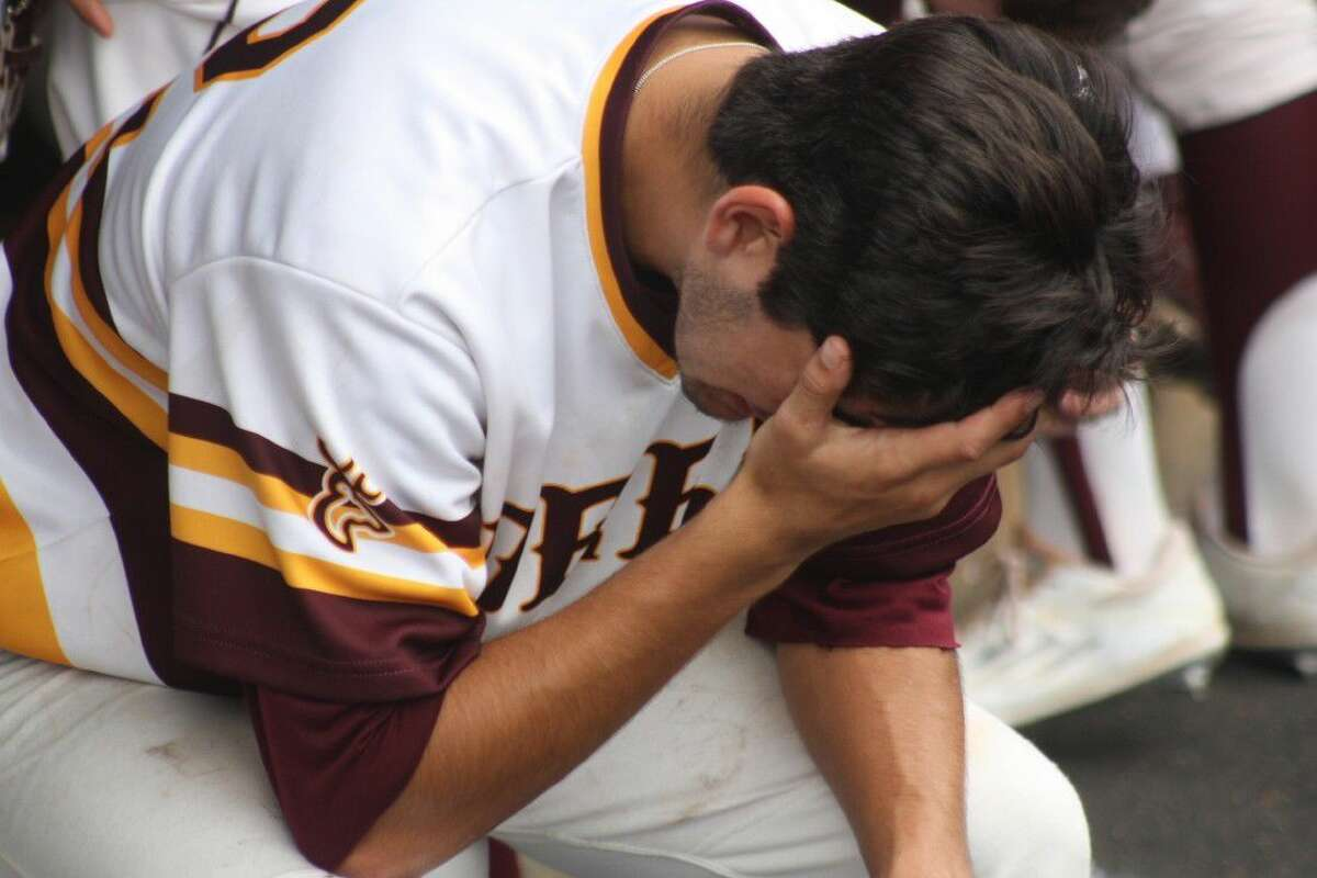 An anguished Adrien Gonzales tries to come to grips with the realization that Deer Park's season is over. Gonzales pitched one-hit ball over five innings of work in the Game 3 defeat.