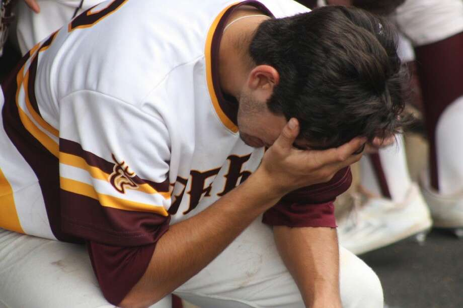 An anguished Adrien Gonzales tries to come to grips with the realization that Deer Park's season is over. Gonzales pitched one-hit ball over five innings of work in the Game 3 defeat. Photo: Robert Avery