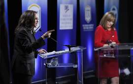 California U.S. Senate Democratic candidate California Attorney General Kamala Harris, left, speaks as Congresswoman Loretta Sanchez, center, listens during a debate, Wednesday, Oct. 5, 2016, in Los Angeles. (AP Photo/Mark J. Terrill)