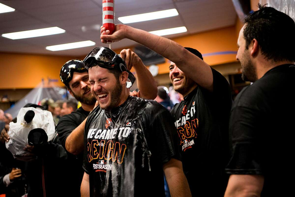 San Francisco Giants pour champagne in the lockeroom as they beat the New York Mets 3-0 in the NL Wild Card Playoff game between the New York Mets on Wednesday, October 5th, 2016.