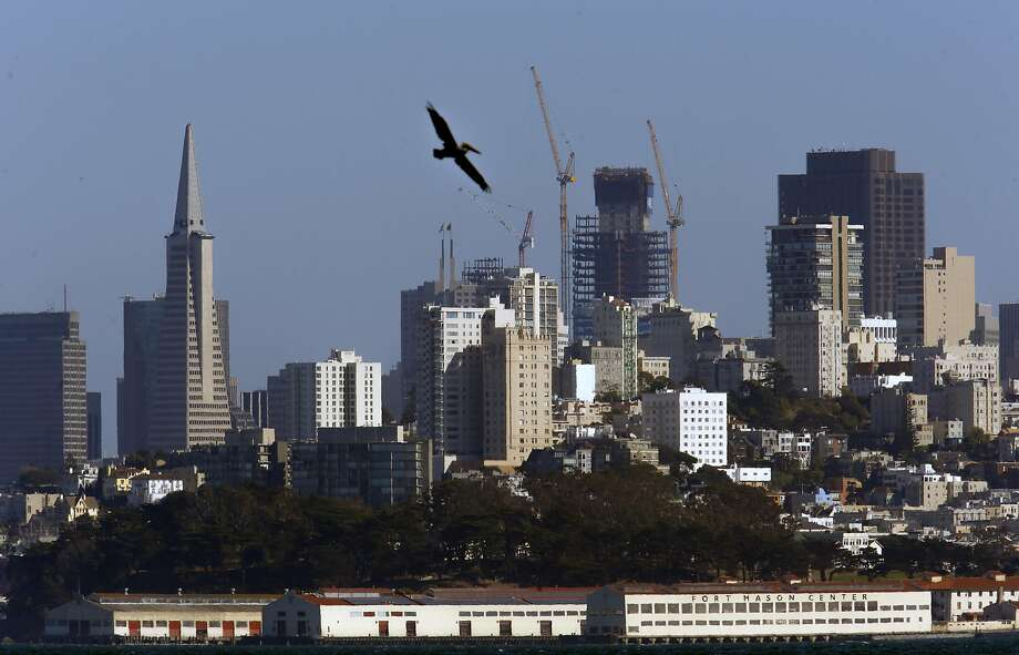 The Transamerica Pyramid soon will lose its decades-long title as S.F.'s tallest building. The honor will go to the still-ascending Salesforce Tower (right center). Photo: Michael Macor, The Chronicle