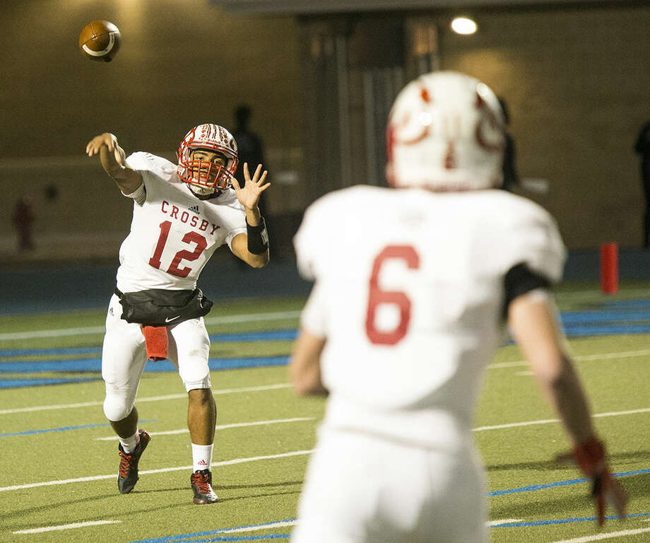 Cougars quarterback Tristen Cotton (12) and Crosby will take on Beaumont Ozen at 7 p.m. Thursday atRay Maddry Memorial Stadium in Channelview. Photo: ANDREW BUCKLEY
