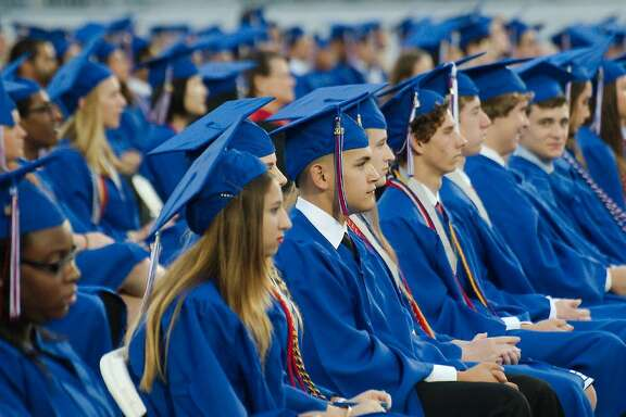 Graduates listen during Clear Lake High School Commencement at Challenger Columbia Stadium Saturday, June 4.