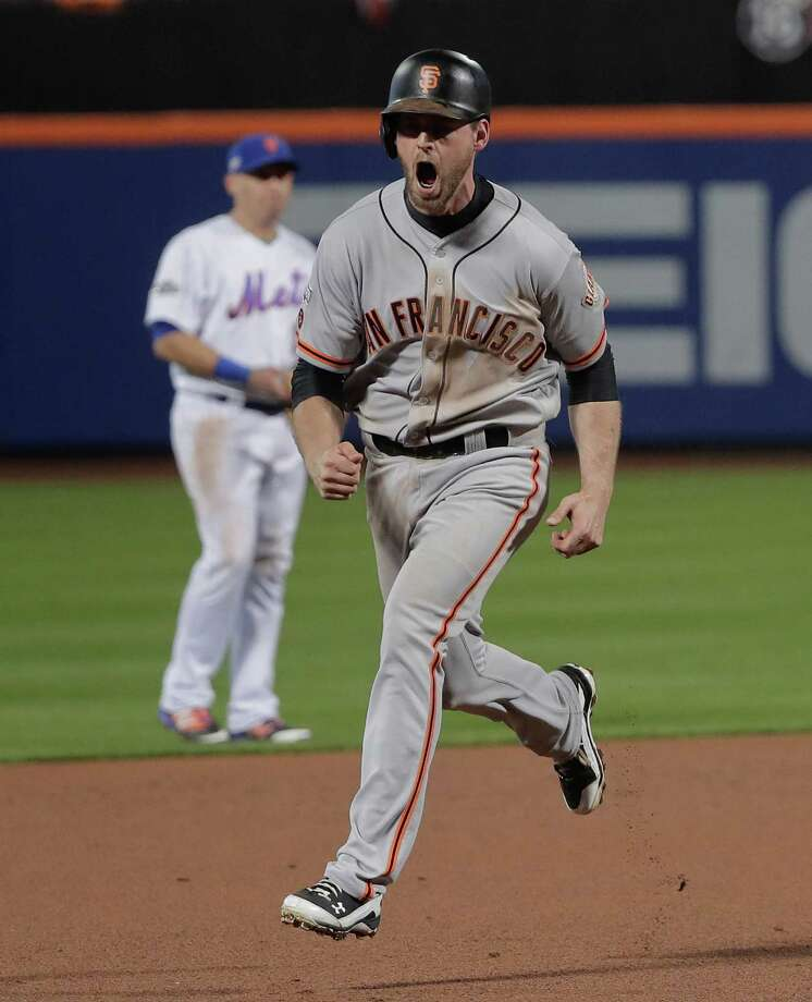 The Giants' heroes were unlikely and expected as No. 8 hitter Conor Gillaspie, left, smacked a three-run homer in the ninth inning to back the shutout pitching of postseason stalwart Madison Bumgarner. Photo: Julie Jacobson, STF / Copyright 2016 The Associated Press. All rights reserved.