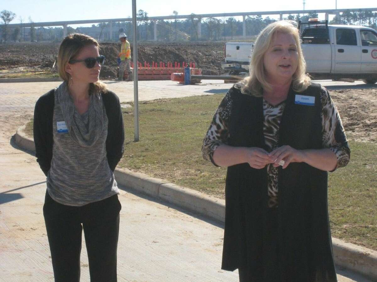 Kroger representatives Joan Vogel and Dani Murphy-Cannella speak about attributes of the Kroger Marketplace in New Caney's Valley Ranch Town Center.