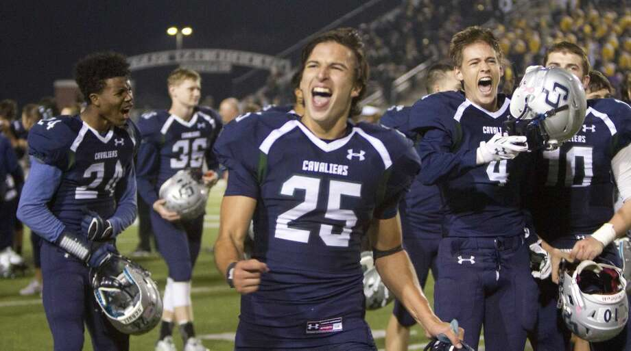College Park wide receiver Jonathan Hayes, defensive back Nick Bustamante celebrate after the team's 27-24 win over Conroe during a high school football game Friday. To view or purchase this photo and others like it, visit HCNpics.com. Photo: Jason Fochtman
