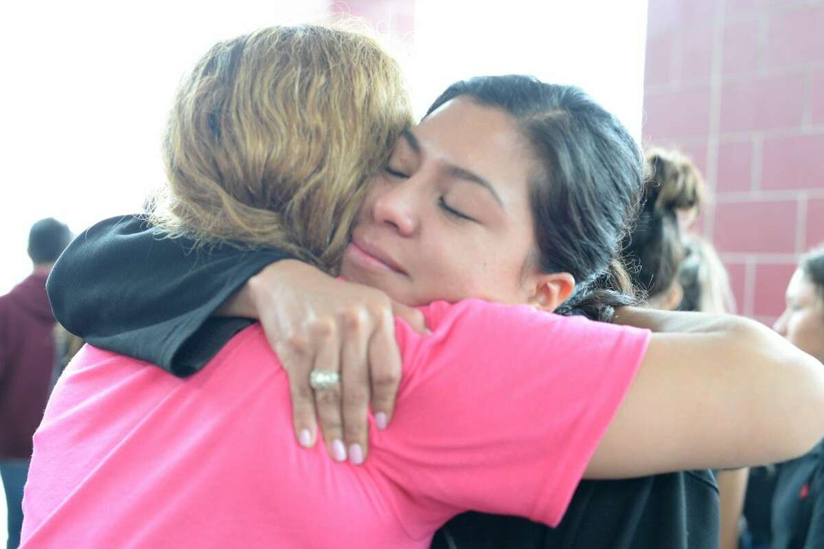 Friends comforted family members Saturday morning at a memorial walk for Karen Perez, who was found dead last week.