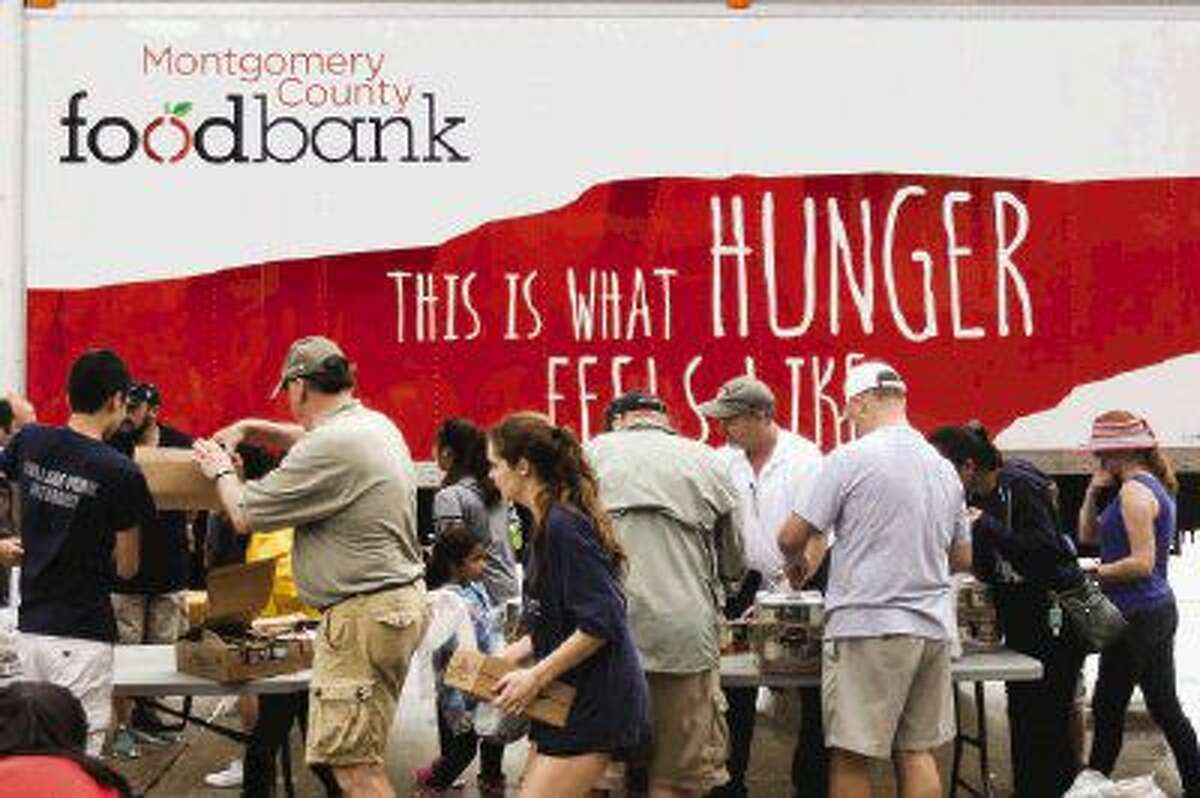 Volunteers organize canned goods and produce during the Shenandoah Food Fair on Saturday at Woodforest Bank Stadium.