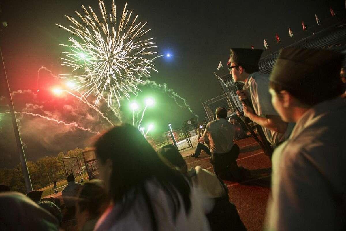 The Crosby High School JROTC watches as fireworks end the Eastside Veteran's Celebration on Nov. 6, 2014, at Crosby High School.
