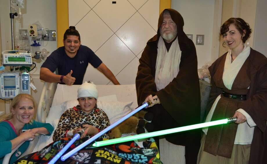 Members of the 501st Legion, a worldwide Star Wars fan club that celebrates the Star Wars universe using costumes and props, stopped by Children's Memorial Hermann Hospital to see 10-year-old Lilly Flowers, a Star Wars enthusiast who has been hospitalized with repeated seizures.