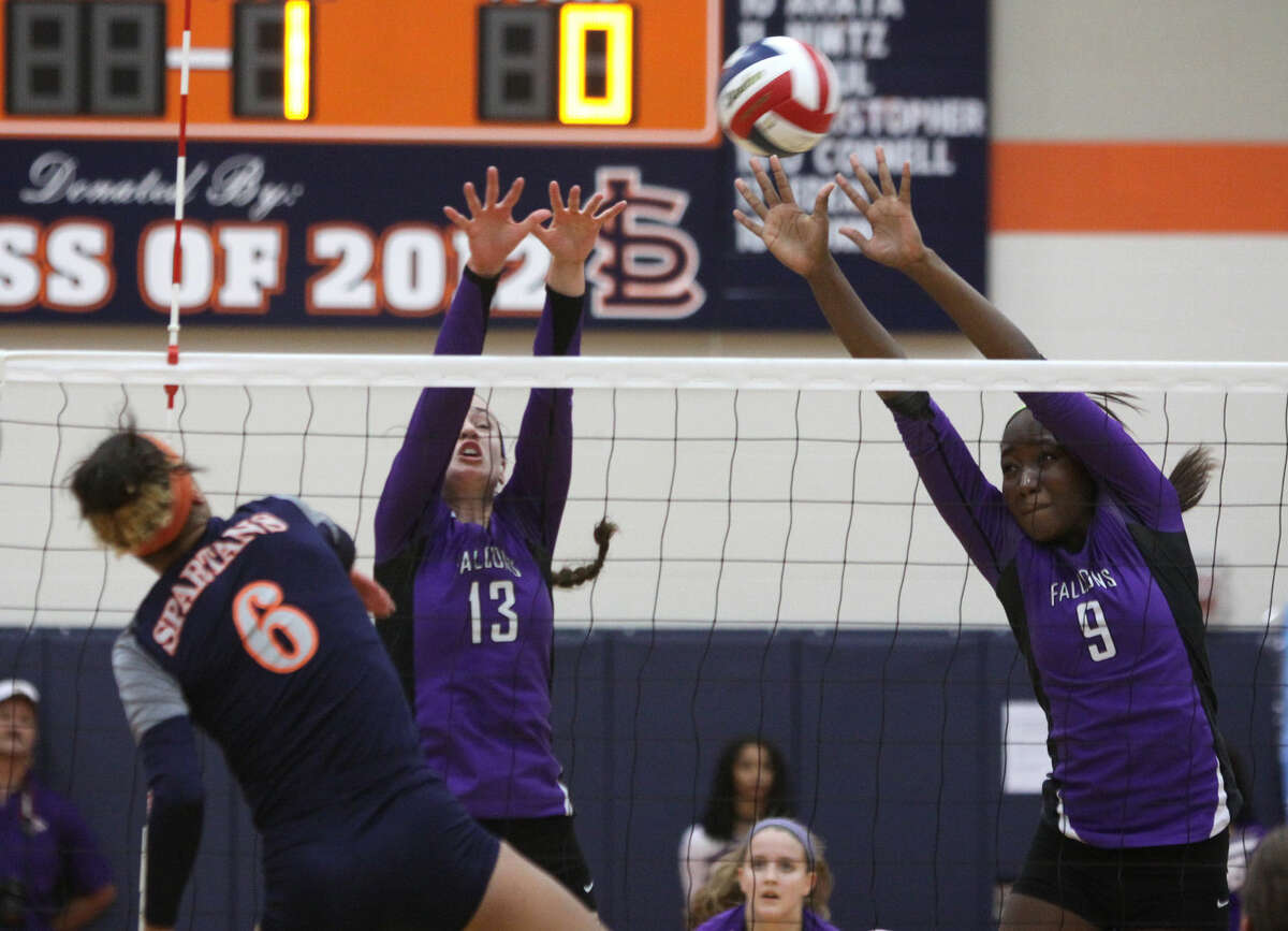 Jersey Village's Becca Mauer and Tyeranee Scott try to block Seven Lakes' Michaela Daniels during a 6A Area Volleyball Playoff at Seven Lakes High School in Katy, Texas on Friday, November 7, 2014.