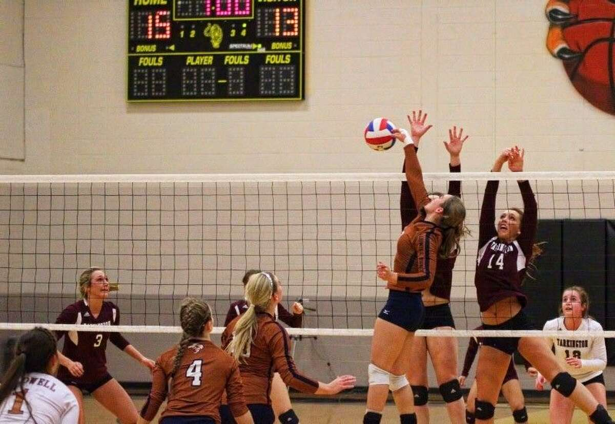 Caldwell's Haylie Ewald gets the ball past Tarkington defenders Dawn Walker and Anna Anderson (14) in their Area Volleyball Playoff game, Nov. 6, 2014.