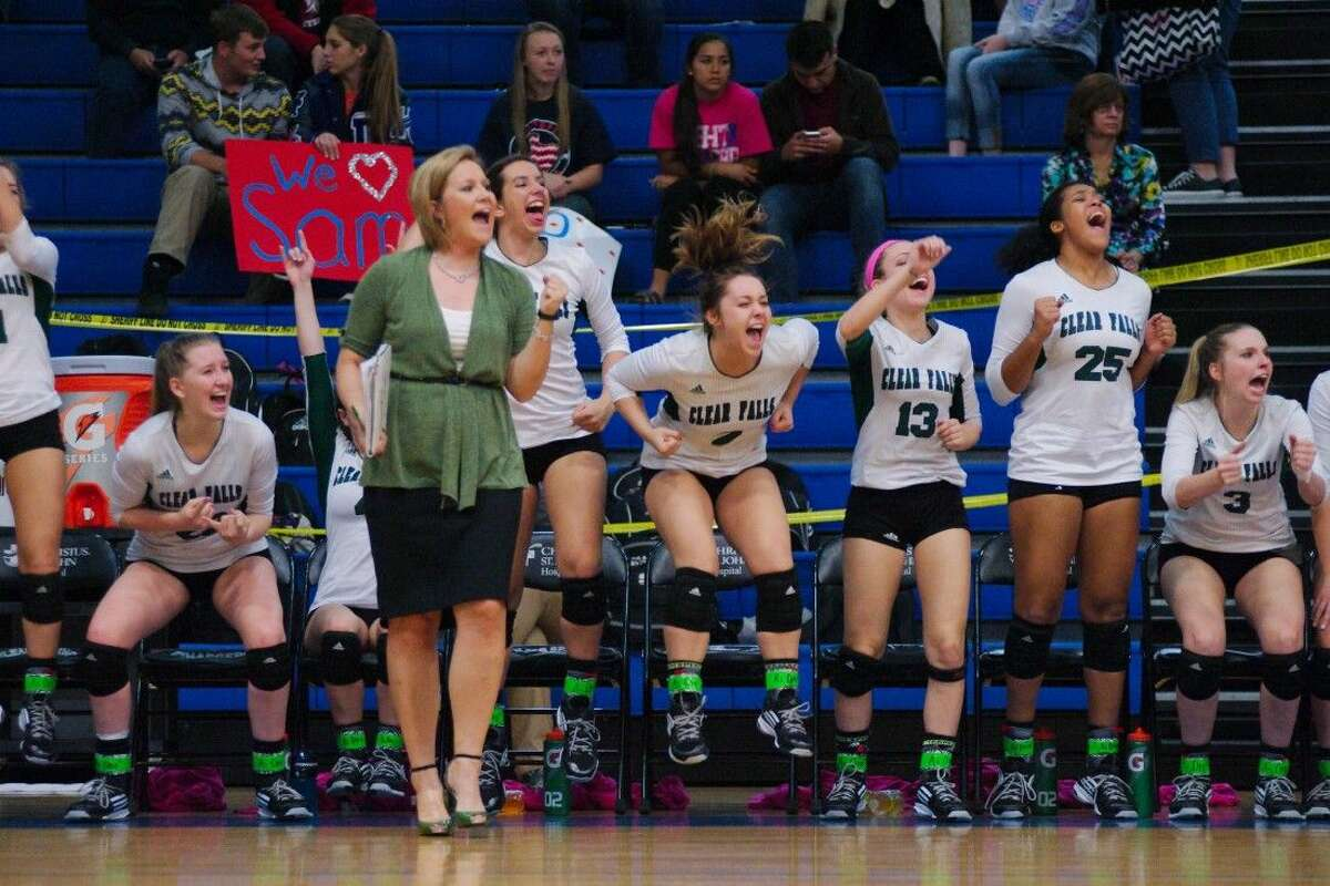 Clear Falls volleyball coach Lyndsay Hodges and the Lady Knights celebrate a point against Clear Lake Tuesday night.