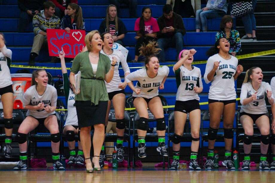 Clear Falls volleyball coach Lyndsay Hodges and the Lady Knights celebrate a point against Clear Lake Tuesday night. Photo: KIRK SIDES