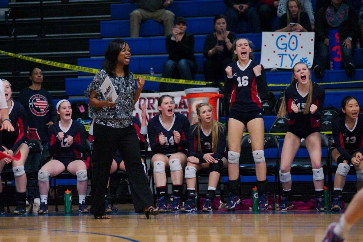 Clear Lake volleyball coach Chanda Eager and the Lady Falcons celebrate a point against Clear Falls Tuesday night.