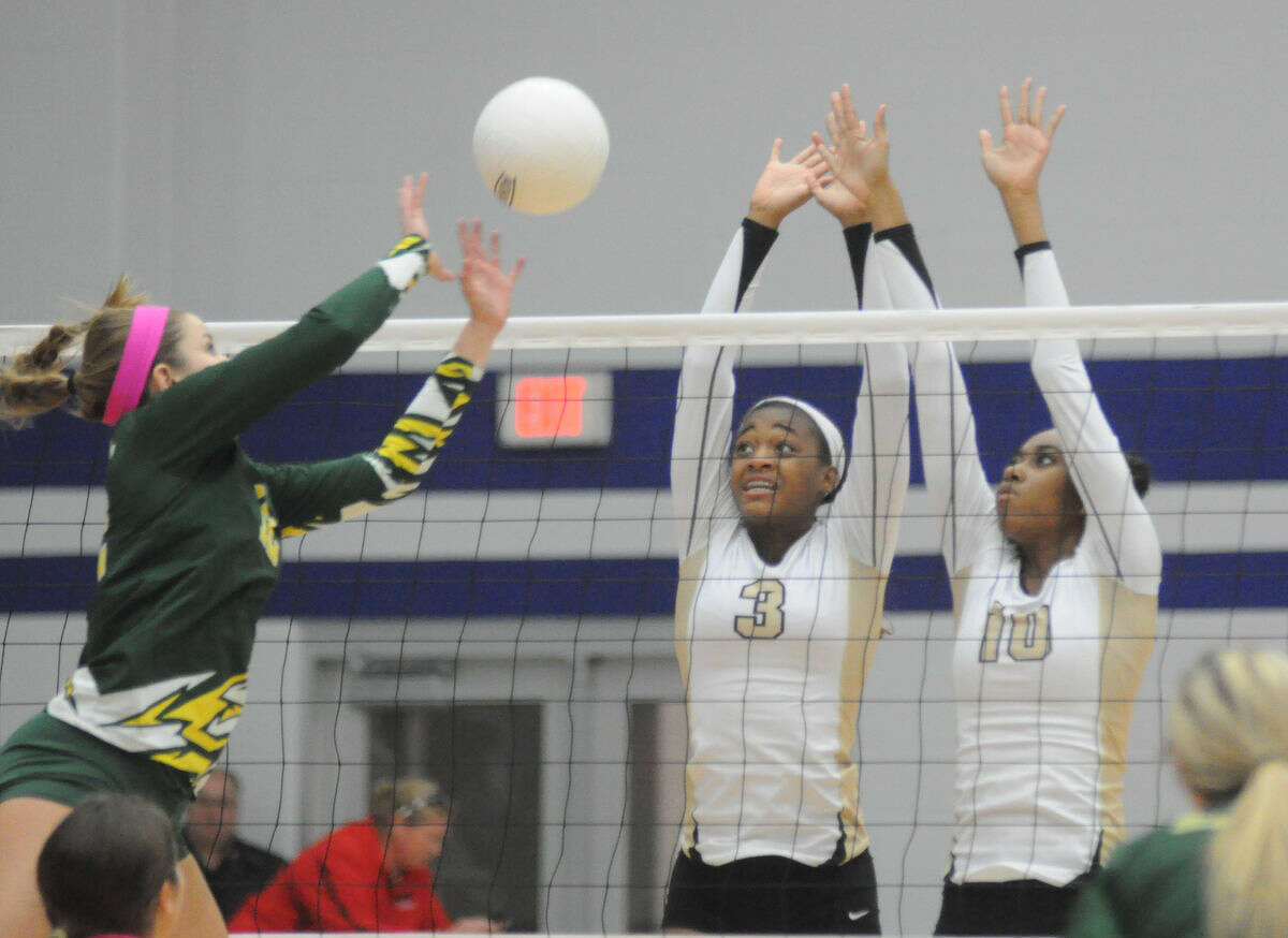 Porter's Marqia Jefferson and Shelby Williams tries to stop a shot against Santa Fe in the Region III-5A quarterfinals on Tuesday at Channelview High School.