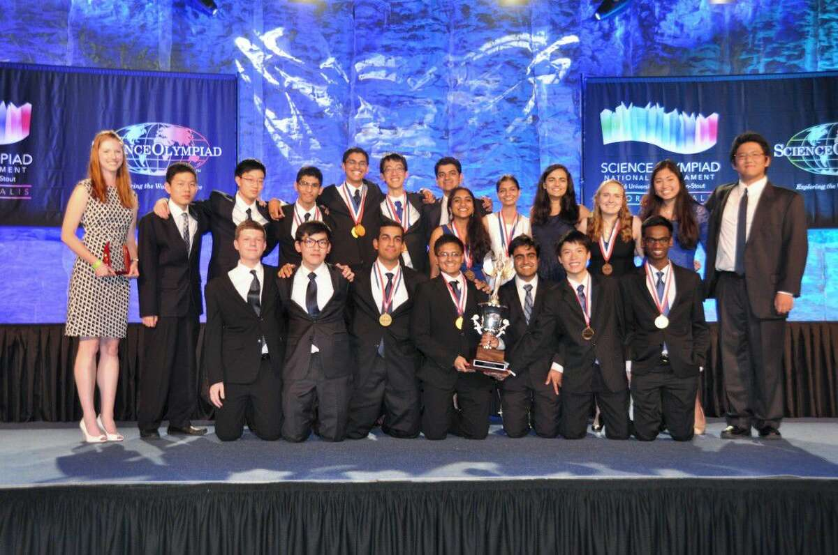 The Seven Lakes High School National Olympiad team with their trophies. The team competed against the top 60 high school teams in the nation in 23 events, receiving third place overall and top 10 in 14 individual events, including four first-place finishes.