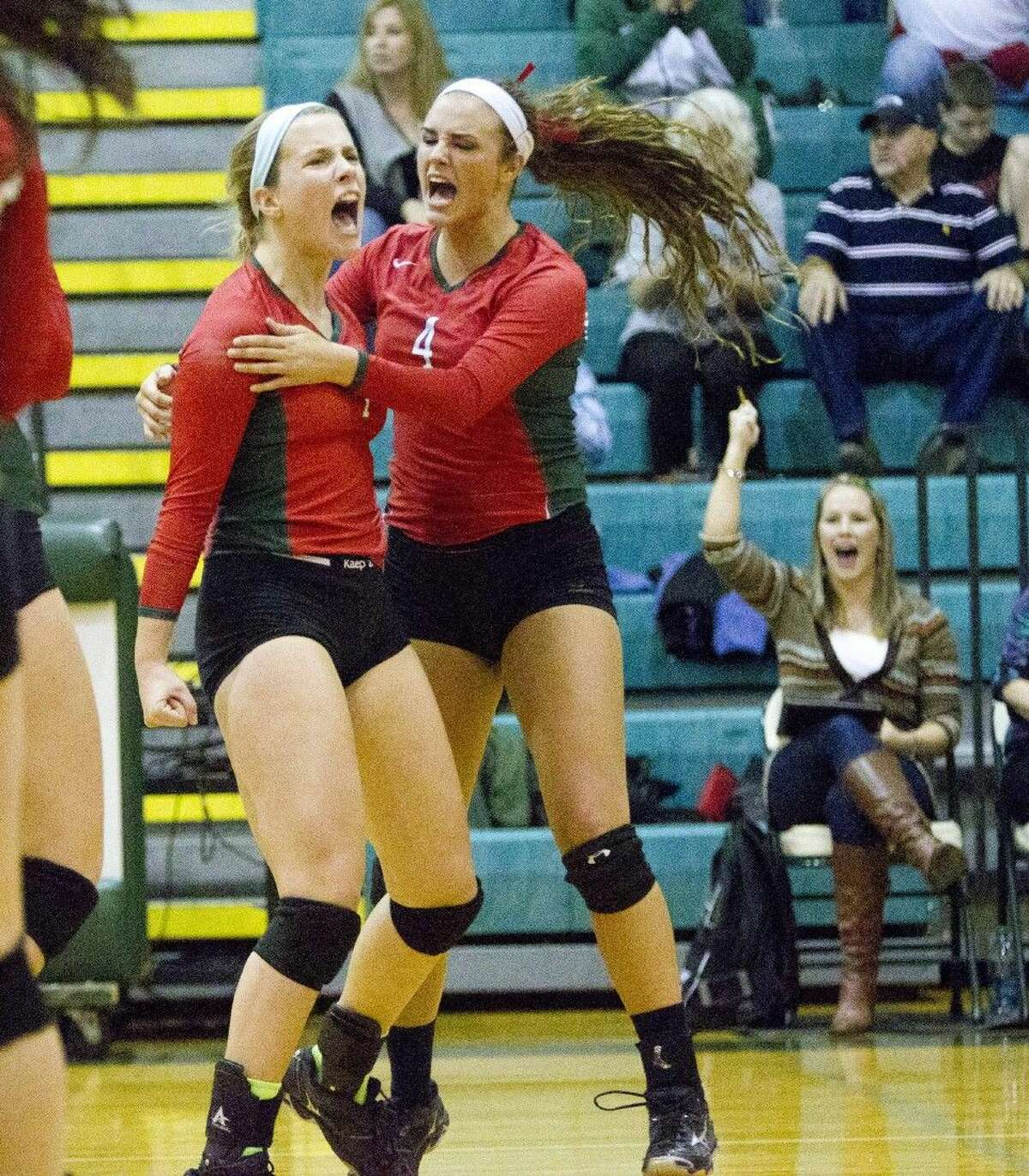The Woodlands' Hannah Hickman, left, and Kendall Cook celebrate a point during a Region II-6A quarterfinal match against Round Rock Westwood on Tuesday at Brenham High School. To view or purchase this photo and others like it, visit HCNpics.com.
