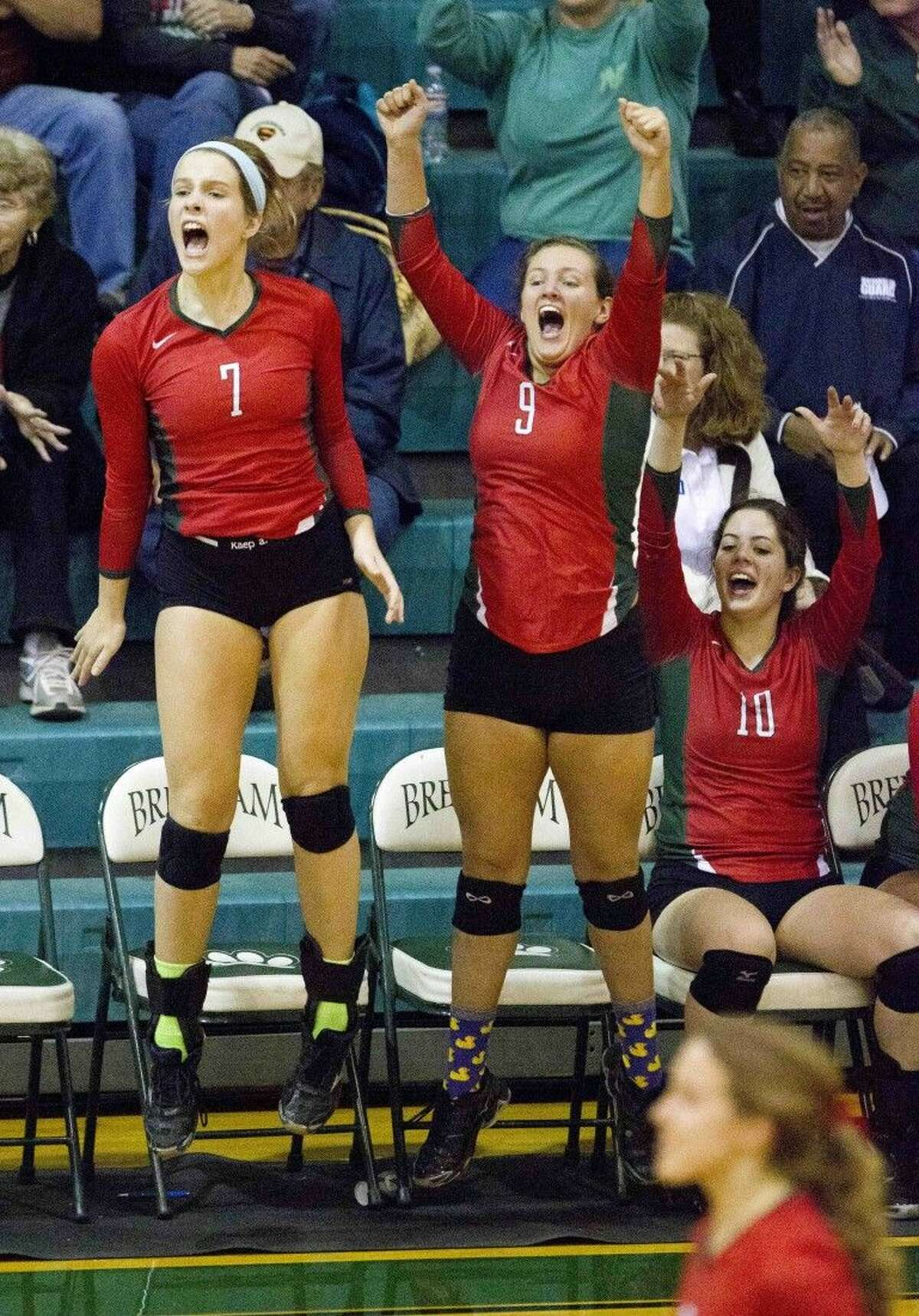From left, The Woodlands' Hannah Hickman, Grey Kennedy and Bella Pinton celebrate a point during a Region II-6A quarterfinal volleyball match against Round Rock Westwood on Tuesday at Brenham High School. To view or purchase this photo and others like it, visit HCNpics.com.